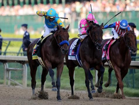 American Pharoah (#18 on the left) winning the 2015 Kentucky Derby (Reuters Photo)