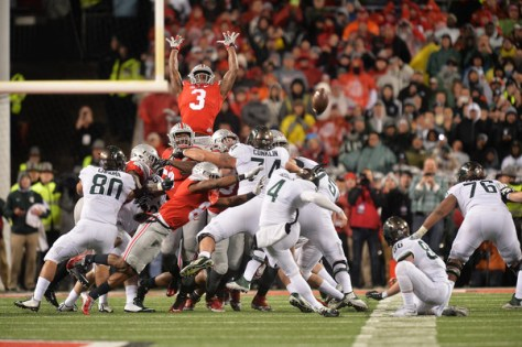 Michael Geiger kicks the game winning field goal for Michigan State against Ohio State. (Jamie Sabau/Getty Images North America)