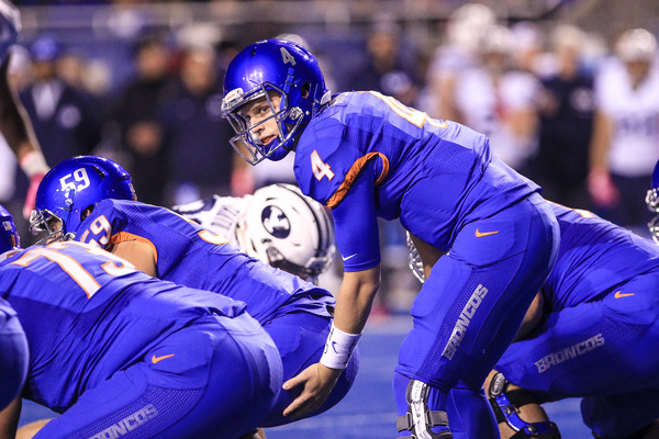 Brett Rypien (#14 above) and the Boise State Broncos have a big clash against the Wyoming Cowboys in Week 9. The winner of this game will be in control of the Mountain West's Mountain Division. (Loren Orr/Getty Images North America)