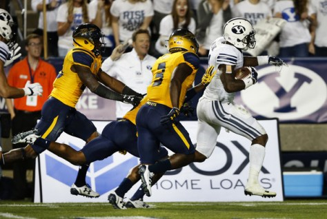 Jamaal Williams (in white) and BYU will face Michigan State this week. Williams ran for 286 yards and 5 touchdowns against Toledo in week five. (George Frey/Getty Images North America)