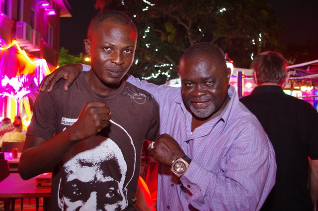 Prince Dornu-Leiku poses with boxing legend, Azumah Nelson in the year 2014 under review