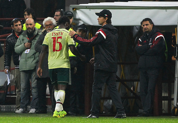 Essien is consoled by AC MIlan coach, Filipo Inzagghi afetr he was sent off