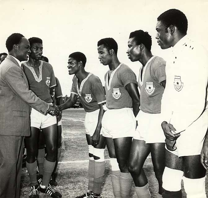 Dr. Kwame Nkrumah greets players of the national before a game in 1962
