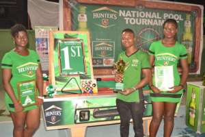 National-Pool-Tournament-2015-winner-poses-with-prizes