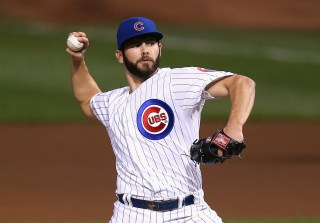 CHICAGO, IL - SEPTEMBER 16: Starting pitcher Jake Arrieta #49 of the Chicago Cubs delivers the ball against the Cincinnati Reds at Wrigley Field on September 16, 2014 in Chicago, Illinois. (Photo by Jonathan Daniel/Getty Images) ** OUTS - ELSENT, FPG - OUTS * NM, PH, VA if sourced by CT, LA or MoD **