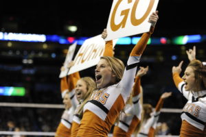Oklahoma City, OK - December 18, 2014 - Chesapeake Energy Arena: Cheerleader of the University of Texas Longhorns during the 2014 NCAA Division I Women's Volleyball Tournament semifinal game (Photo by Eric Lars Bakke / ESPN Images)