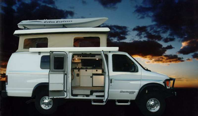 A White Custom Sportsmobile 4x4 Camper Conversion With The Top Up