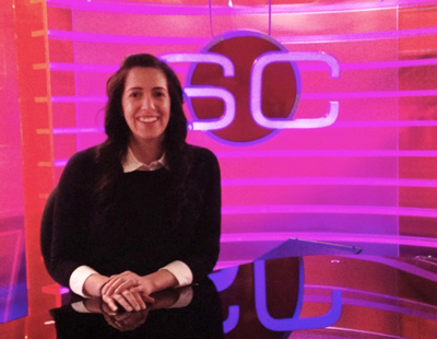 """It is 24/7 sports here, so it's important to have an interest in, and passion about,  sports,"" says Teresa Causin, posing at ESPN's SportsCenter desk."