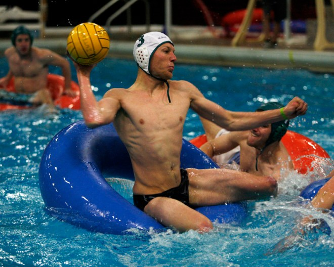 An intertube water polo player gets ready to throw the ball. (CU Independent/Robert R. Denton)