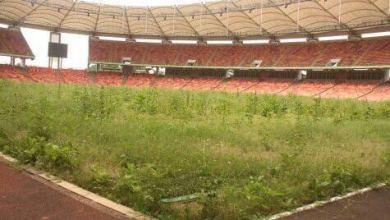 Photo of President Buhari renames Abuja Stadium after MKO Abiola