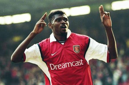 Kanu celebrating one of his goals