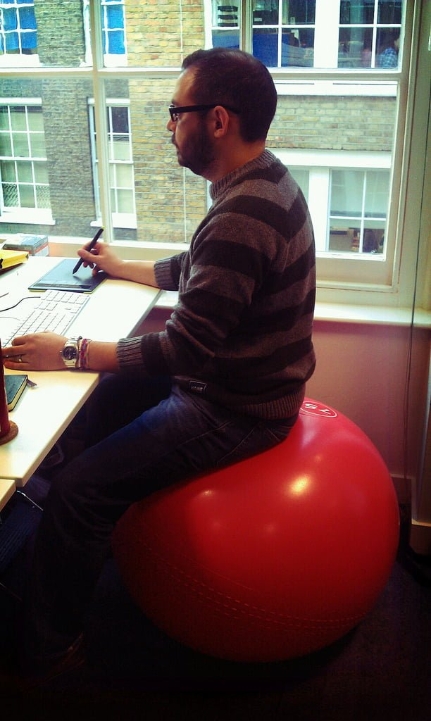 Stability ball and low back pain in office workers