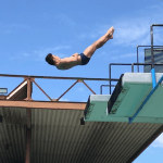 Daniel Zabronsky kicking out of a back dive tuck from the 5 meter platform.