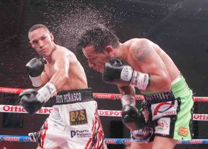 Estrada (left) lands a sweat-flying left hook on Marquez (right)