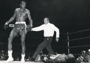 Foster (left) moments after he landed a left hook on Dick Tiger (right) to win the light heavyweight title