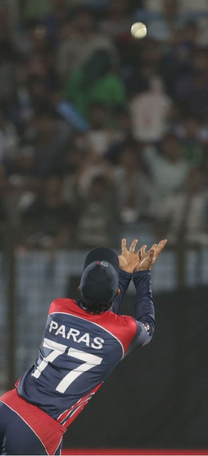 Paras Khadka in a process to take a stunning catch