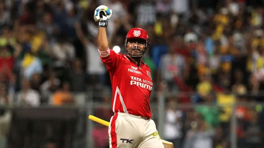 An emotional Virender Sehwag celebrating his second IPL hundred