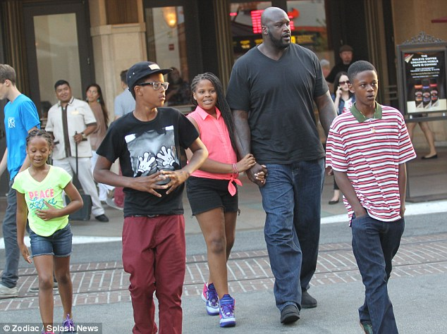 Shaquille pictured with his children in 2012