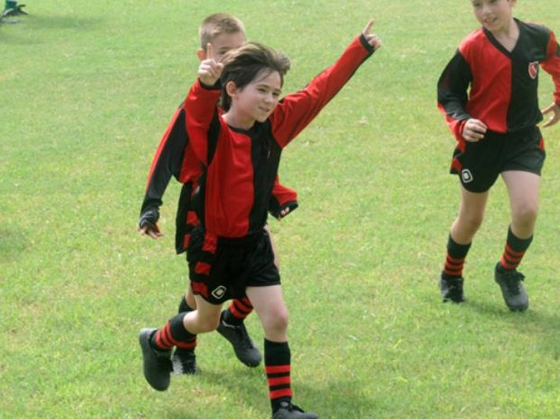 Young Lionel Messi celebrating a goal at Newell's Old Boys
