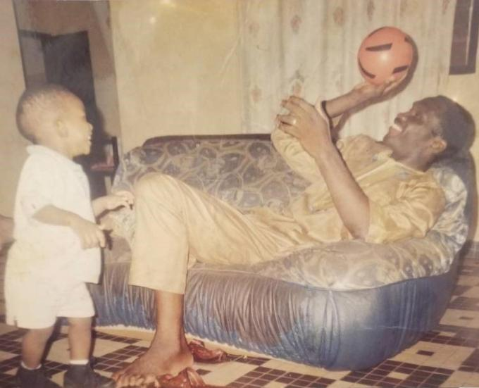 Young Joel Embiid playing with his father