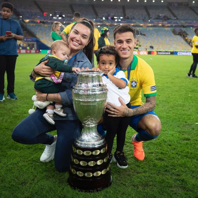 Philippe Coutinho with his wife and children