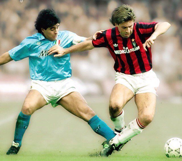 Photo of Carlo Ancelotti of AC Milan tackled by Diego Maradona of Napoli