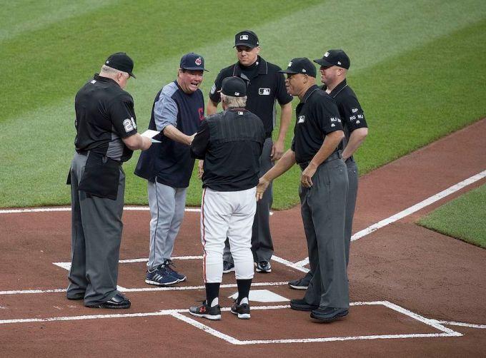 Cleveland coach and Umpires – Bill Miller (26), Adam Hamari (78), Kerwin Danley, Ryan Blakney