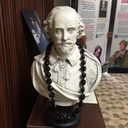 Bust of Shakespeare wearing the traditional kukui nut lei.