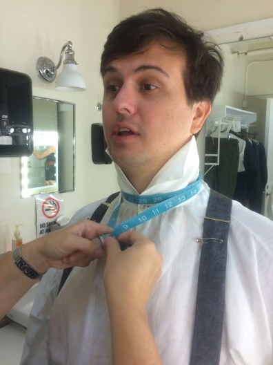 Measuring Jamie Smithson for his necktie.