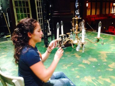 Assistant Technical Director Rebekah Sheffer works on a chandelier.