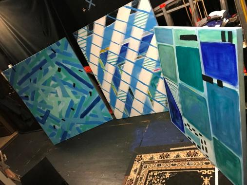 The finished paintings backstage.