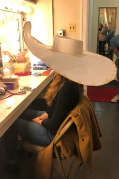 Alison Luff tries on a model of her hat as Nell Gwynn.