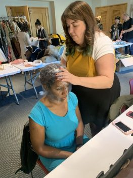 Wig builder Lucy Wakeland wraps Amanda Bailey (Venticello) for a wig. Photo: Katelyn Manfre.
