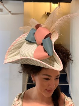 Lilli Hokama modelling Constanze's replacement hat. Amadeus, Folger Theatre, 2019. Costume Design and Photo: Mariah Anzaldo Hale.