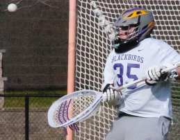Voorheesville goaltender Evan O'Connor eyes an incoming shot during the first quarter of a Colonial Council game against Maple Hill Wednesday, April 13. Rob Jonas/Spotlight
