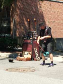 A street performer entertains the crowd gathered at River and First Streets during Troy River Fest on Saturday, June 18.
