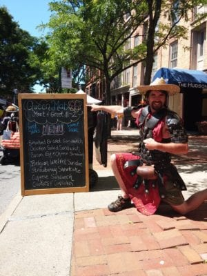A costumed actor promotes the upcoming Enchanted City Steampunk Street Fair outside of Sweet Sue's on River Street during Troy River Fest on Saturday, June 18.