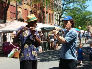 A pair of flutists play during Troy River Fest on Saturday, June 18.