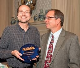 Dan Lilkas-Rain, Recycling Coordinator for the Town of Bethlehem, (left) is presented with the 2016 Recycling Leadership Award by NYSAR3 President Jim Gilbert.