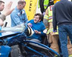 Emergency crews treat Russell Schwimmer on April 17 (Photo by Jim Franco/Spotlight News)