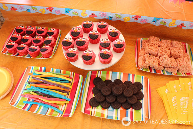 Elmo 2nd #Birthday #Party - dessert table including Elmo cupcakes | spotofteadesigns.com