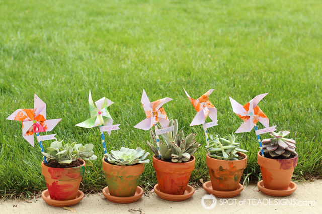 Mother's Day Kids' Craft - Painted Terra Cotta Pots with Pinwheel name labels #mothersday #kidscraft | spotofteadesigns.com