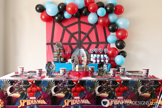 5+ budget friendly spider-man party hacks - crepe streamers to create spider web backdrop | spotofteadesigns.com