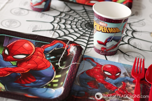 5+ budget friendly spider-man party hacks - diy table runner accent made with cricut cutting machine   spotofteadesigns.com