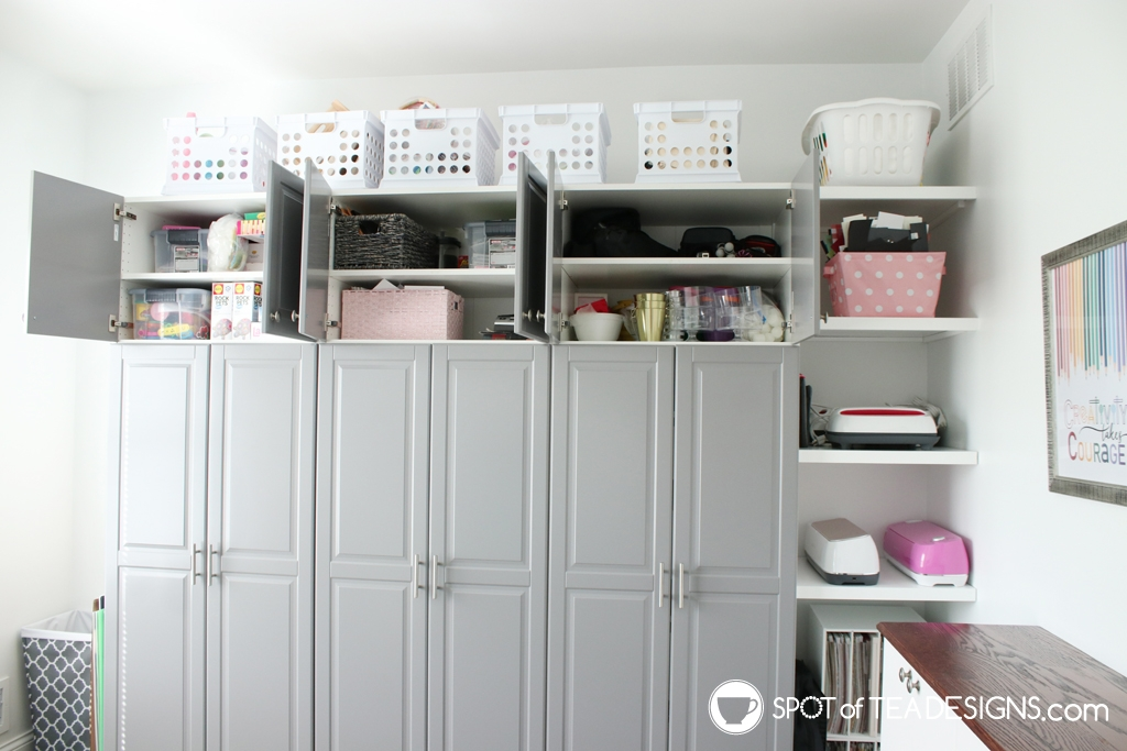 Craft Room Tour - top cabinets open to showcase storage capacity | spotofteadesigns.com