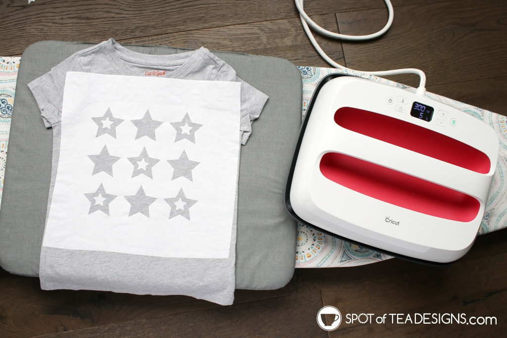 DIY Patriotic T-shirt made with a freezer paper stencil and fabric paint | spotofteadesigns.com