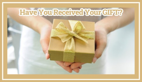 have you received your gift? Photo of a person holding a gift wrapped in gold paper with a gold bow.