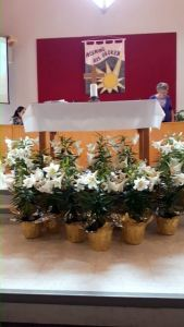 Sanctuary with lilies around the alter