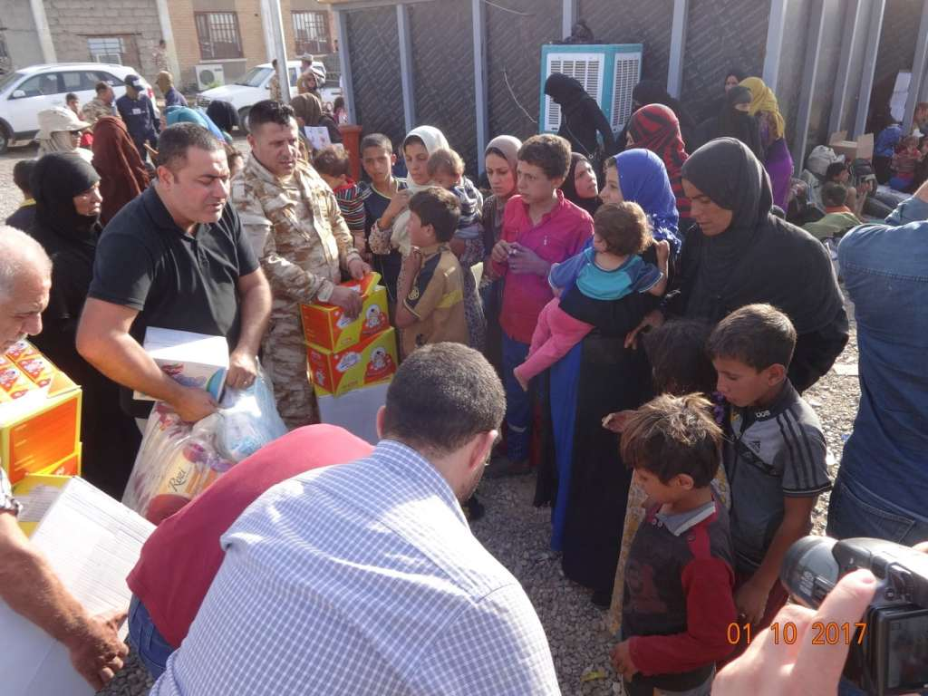 Representatives of the Chaldean Catholic diocese of Kirkuk distribute aid to displaced families earlier this month (October) in Hawija. The center for internally displaced families is 30 miles southwest of the diocesan center where Dominican Friar Yousif Thomas Mirkis is the archbishop. In spite of the challenges Iraq faces Archbishop Mirkis is hopeful about Iraq's future. (Photo credit: Msgr. Yousif Thomas Mirkis, OP, Chaldean Archbishopric of Kirkuk, Iraq.)