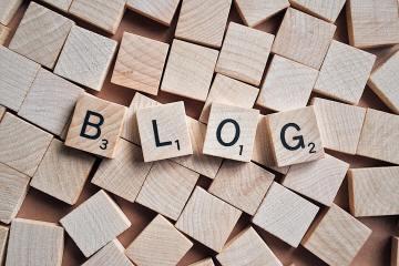 """alphabet tiles spelling the word """"blog"""""""